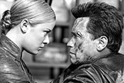 Circuit city: Kristanna Loken and Arnold  Schwarzenegger fry wires in Terminator 3: Rise of  the Machines.