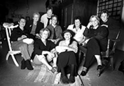 Ladies in waiting: Molly Moyer and Linda Fowler  (standing, from left); Suzanne Keating, Ronnie  Storey-Ewoldt, Maria Elena Guzman, Katie O'Brien  and Jackie St. Joan (middle row); and Nina Sokol and  Rita Singer (front row).