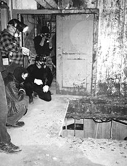 Shock and awe: Subciety members peer into a  formerly submerged section of the silo.