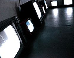 Installation view of the color channel, by  Steven Read, televisions, antennae, UHF waves and  software programs.