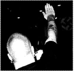 Sieg heil! A Nazi skinhead salutes the swastika at the Rocky Mountain Heritage Fest.