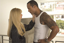 Sarah Michelle Gellar and Dwayne Johnson make an unusual couple in Southland Tales.