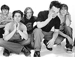 Conor Oberst (second from right) and Desaparecidos.