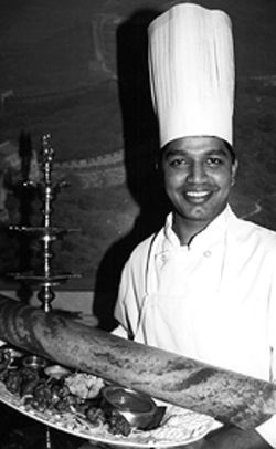 Passage to India: Masalaa chef Subbian Siva shows off a rolled-up dosa.