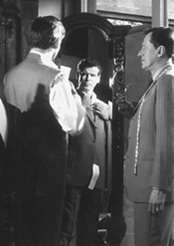 Harry Pendel (Geoffry Rush) suits spy Andrew Osnard (Pierce Brosnan) in The Tailor of Panama.