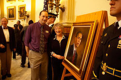 Democratic staffer Paul Weissmann and portrait artist Sarah Boardman hail the chief.
