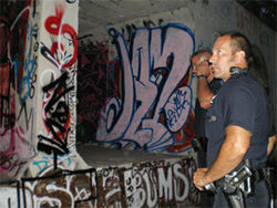 "Denver SCAT officer Mike Felsoci and Sergeant Bob Motyka head into ""The Tunnel."""