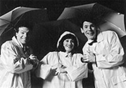 Scott Beyette, Shelly Cox-Robie and Brian Norber in Singin' in the Rain.
