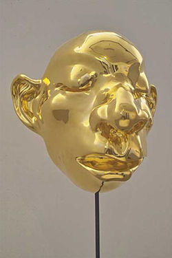 Untitled cartoon-like head, by Fang Lijun, gilt-bronze and steel.