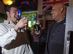 British Bulldog chef Thomas Cortez (left) and owner Isaac James share a pint and a laugh.