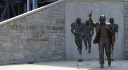 "Joe Paterno: ""Educator, Coach Humanitarian."" The statue of Paterno near Beaver Stadium on the Penn State campus."