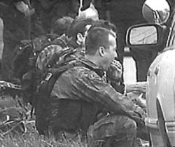 Police inaction: SWAT officers take a break during the five-hour rescue operation at Columbine.