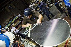 Jose Doton works on boards for the 2011 line at Never Summer's north Denver factory.