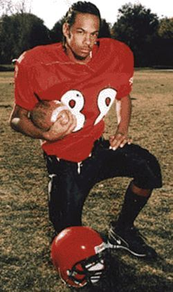 Timothy Kemp posing for a football photo in 2002.