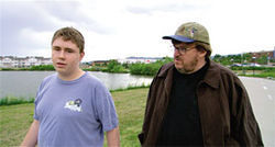 Bitter lessons: Mark Taylor and filmmaker Michael Moore in Bowling for Columbine (2002).