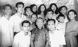 A family affair: The young Sum (third from top  left) with the family he left behind in Vietnam.