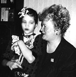 Elvira, soon to be Elena, with an official at the Russian orphanage.