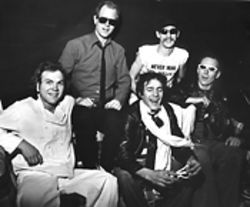 We're with the band (from left): Kamikazi Klones Mike Lenz, Mark Hopkins, Jimy Murphy, Mark Hagen and A.J. Coon backstage at the Rainbow Music Hall before opening for the Motels.