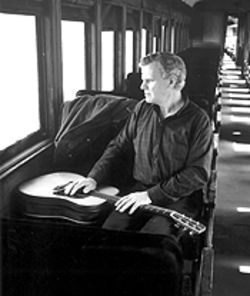 Doc Watson and his guitar continue down the line.