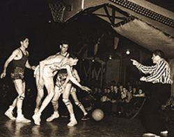 "Gordon ""Shorty"" Carpenter (from left), Robert ""Ace""  Gruenig and John ""Pop"" Freiberger in the 1943 AAU  championship game."