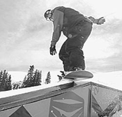 Cold comforts: Jessica Johnson does a board slide at  Loveland's terrain park.