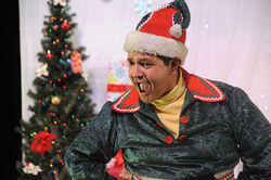 Matt Zambrano as Crumpet the Elf in The SantaLand Diaries.