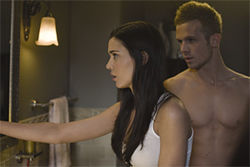 Odette Yustman tells Cam Gigandet about a mystery in her mirror in The Unborn.