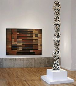 "Martha Daniel's ceramic ""Endless Tower,"" with Emilio  Lobato's oil-on-panel ""Bien Vestido"" in the  background."