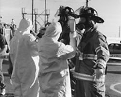 Rocky Flats workers battled hazardous waste in protective suits and with glove boxes.