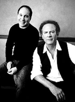 Old friends: Simon and Garfunkel patch things up for  the sake of their fans, Thursday at the Pepsi Center.