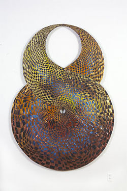 """Circular Construct,"" by Stan Meyer, woven tar paper and metallic pigments."