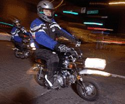 Drive, he said: Another NightRider to the rescue on  his foldable scooter.