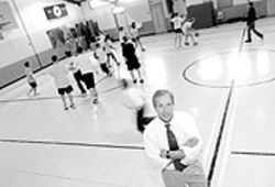 Hoop dreams: Cyphers coaches Holy Family's basketball teams.