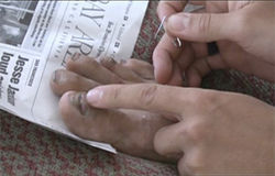 Outstanding feet: A scene from the documentary Indulgence shows Tony Krupicka taking care of his equipment — including his toes.