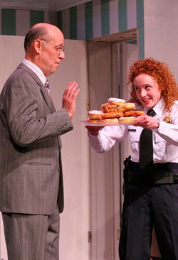 Gary Mitchell and Caitlin Wise in Unnecessary Farce.
