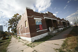 Welton Street Properties owns nineteen parcels at the edge of Five Points, including one at 2255 Glenarm, whose garage has become a drug den.
