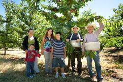 Rosalio Moreno (far right) came to the valley three years ago with his family, and now owns a cherry farm.