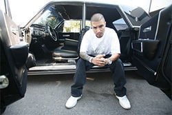 Vett Capone is sitting pretty in Marcus Camby's '64 Lincoln Continental.