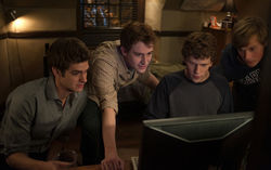 Andrew Garfield (from left), Joseph Mazzello, Jesse Eisenberg and Patrick Maple in The Social Network.