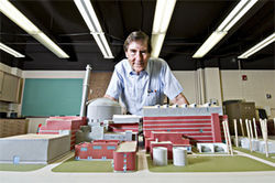 DU physics professor Robert Amme with a scale model of a nuclear reactor.