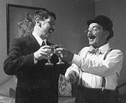 R. Matthew Deans (left) as the baron and Jim Hubbard as bookkeeper Kringelein live it up  at Grand Hotel.