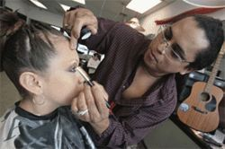 In your eyes: Jaider Sanchez helps get Alejandra  Ramos ready for her quinceañera.